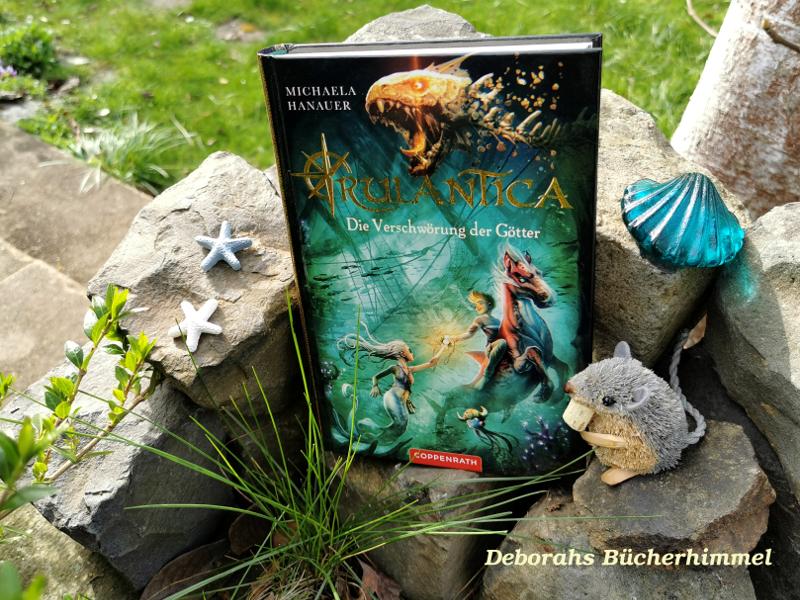 Rulantica 2 - Die Verschwörung der Götter auf Steinen zusammen mit Deko und Blogmaus